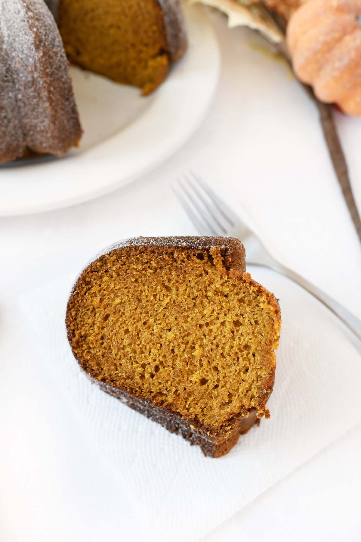 Slice of Pumpkin Cake on a small white plate.