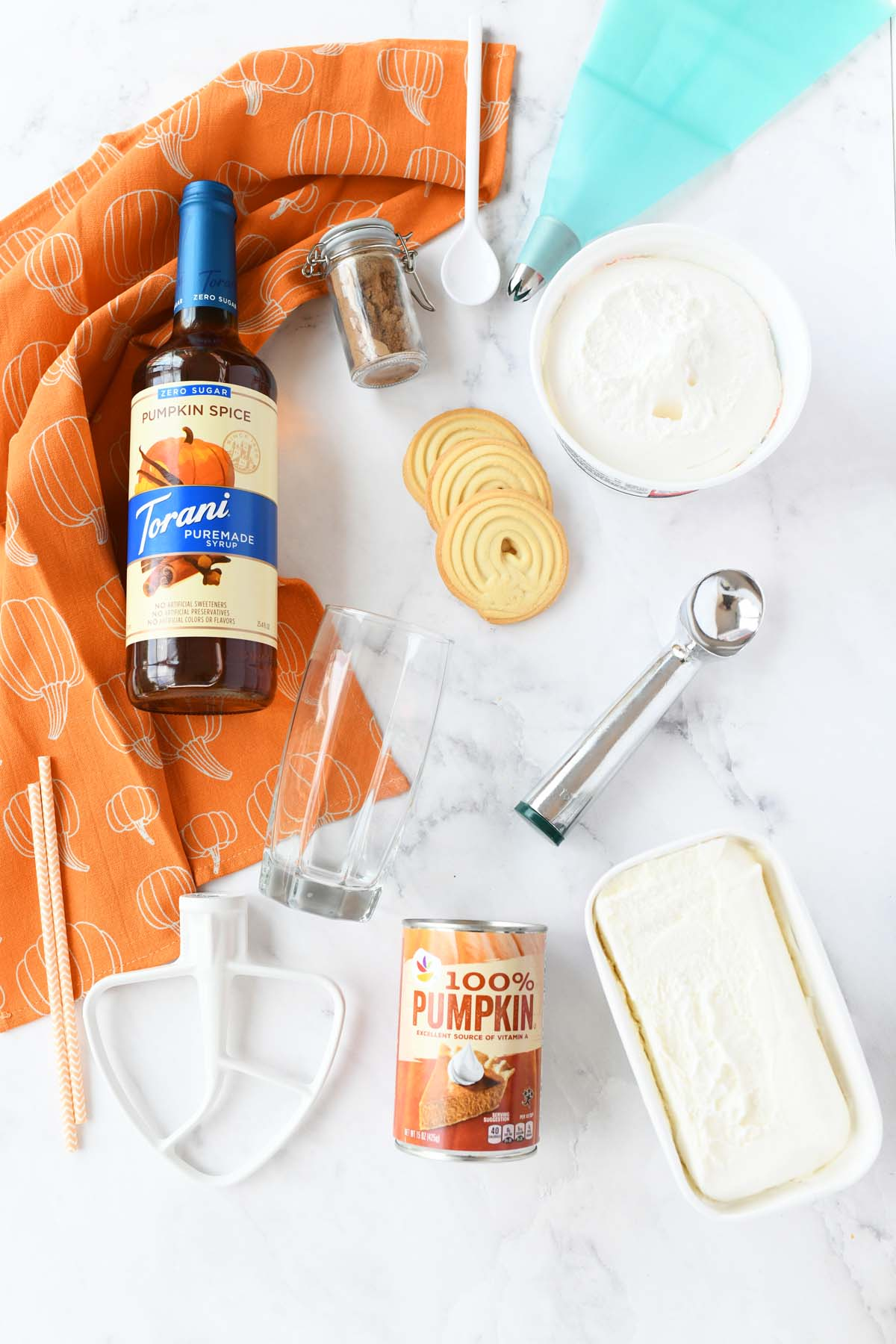 Sugarfree Pumpkin Spice drink ingredients on a white table.