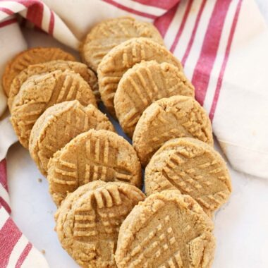 3 ingredient peanut butter cookies on a white table with a napkin.