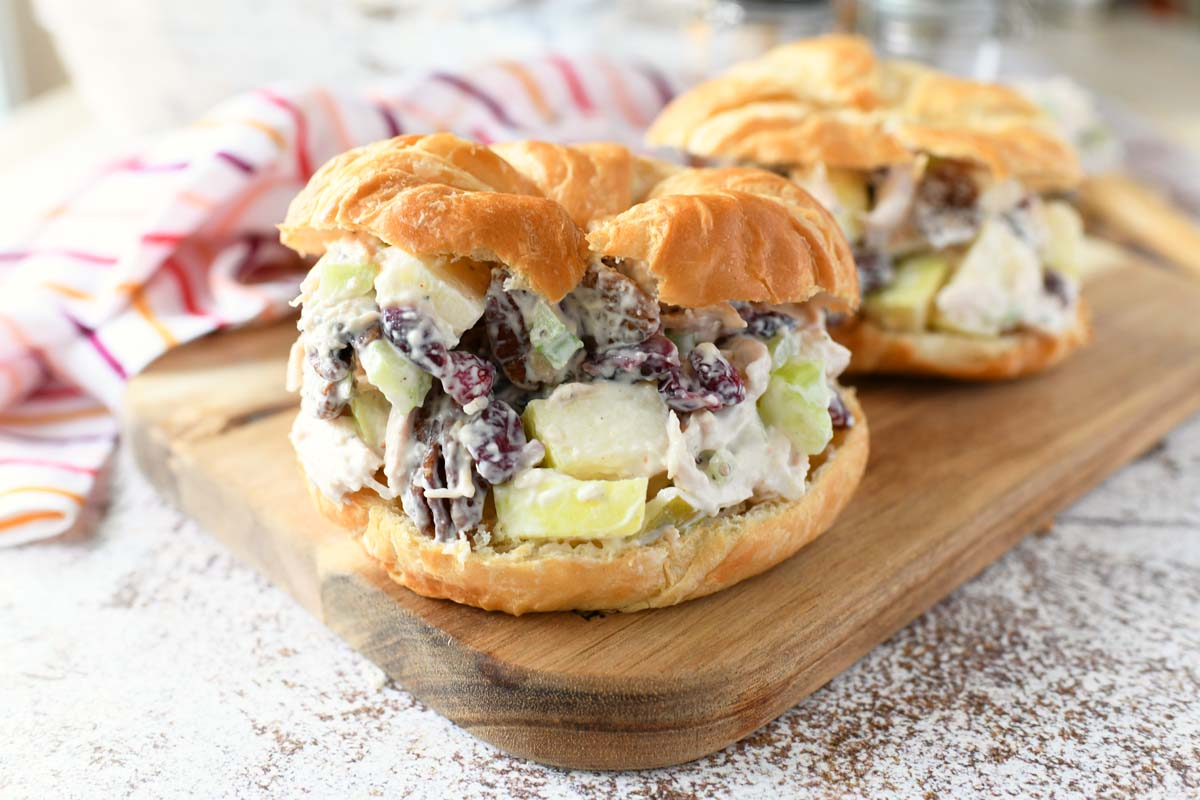 Chicken salad with apples and cranberries on a golden croissant.
