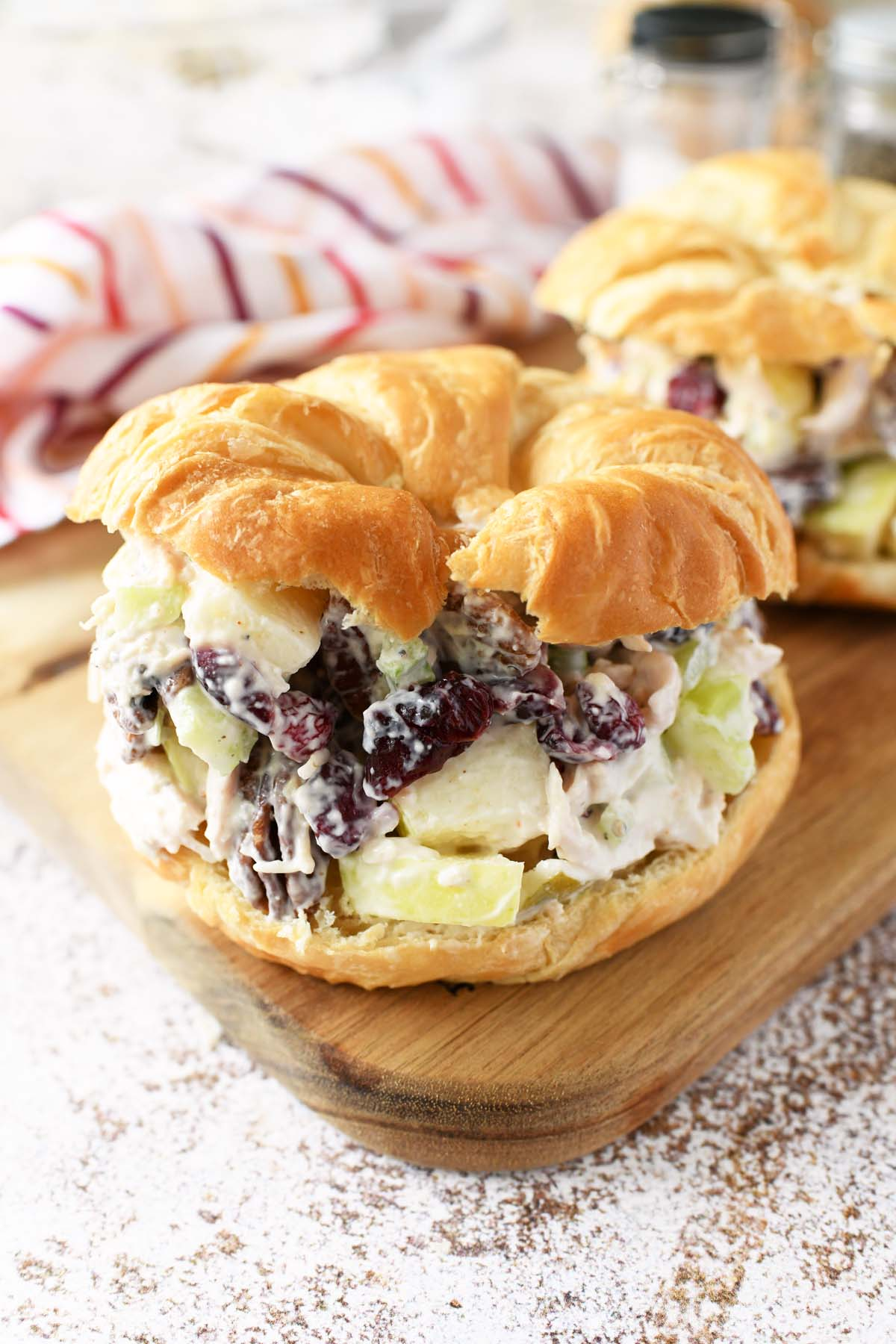 Fall chicken salad is loaded on a golden croissant.