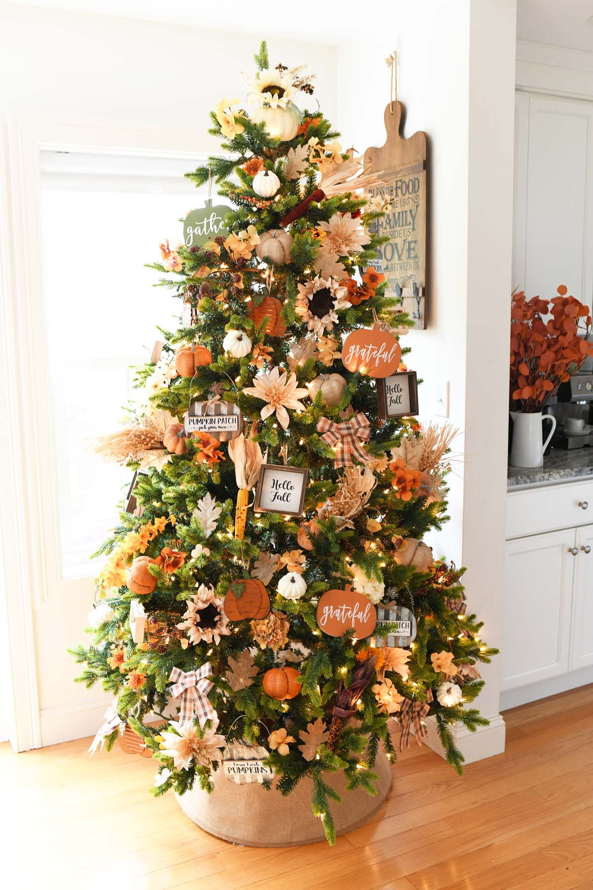 Fall harvest tree decorated with floral and pumpkin decor.