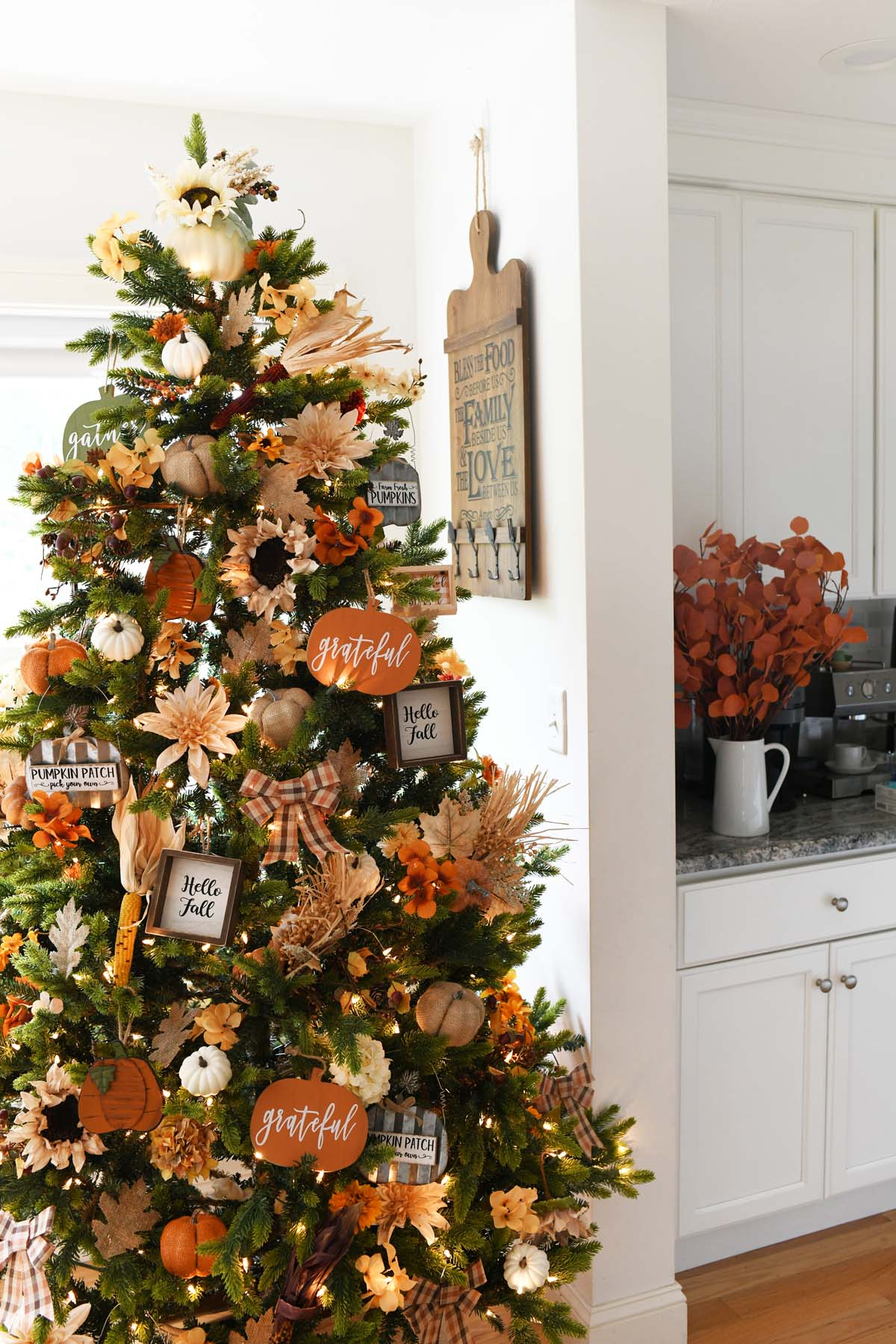 Thanksgiving Christmas Tree Decorated in a white dining room.