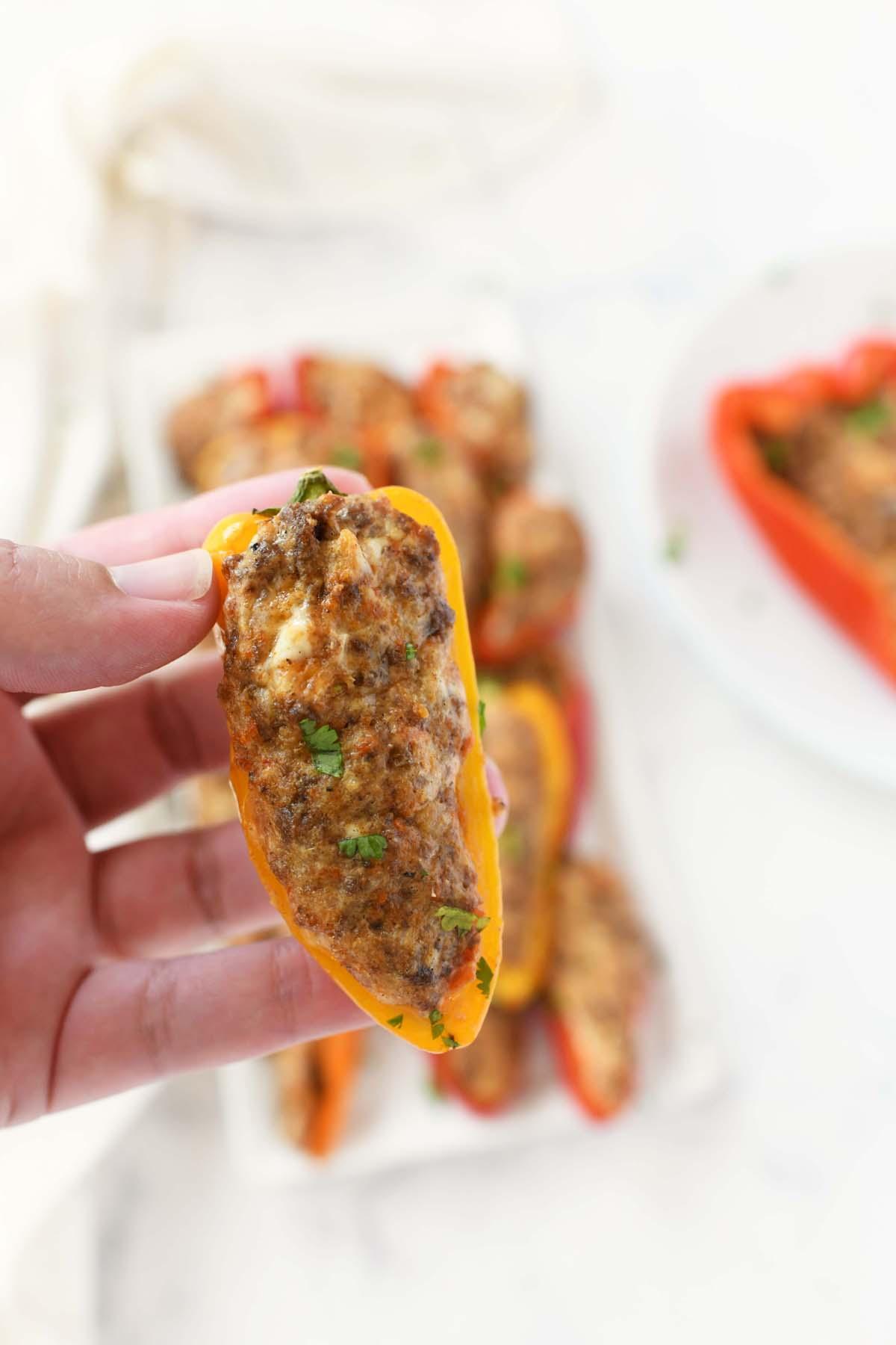 A mini taco pepper in a hand.