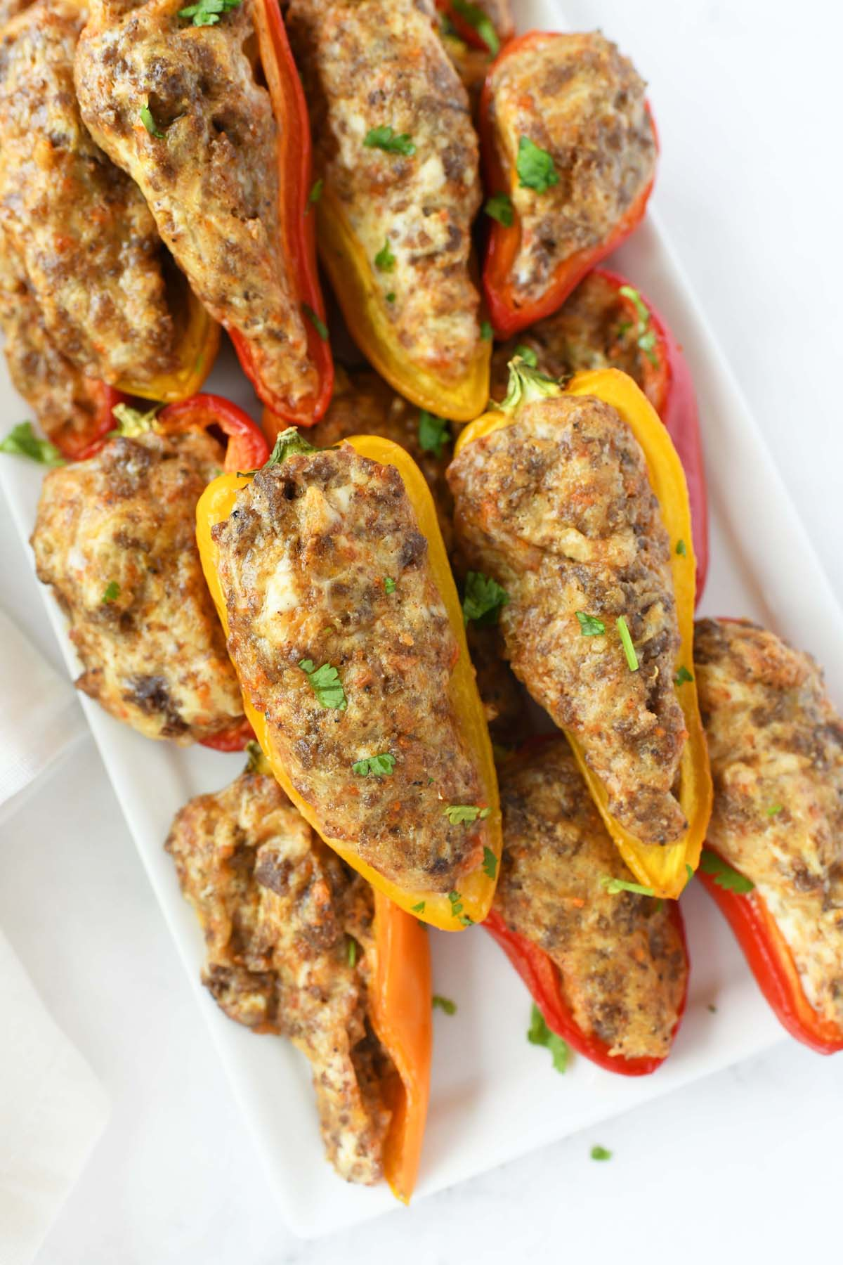Rainbow peppers stuffed with taco cream cheese.